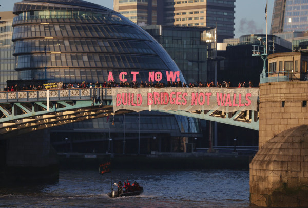 Image: Activists from the Bridges not Walls movement display messages on Tower Bridge in London