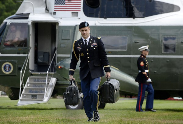"Image: A military aide carries the president's nuclear ""football"""