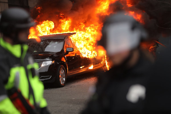 Image: Police and demonstrators clash in downtown Washington, D.C. after a limo was set on fire following the inauguration of President Donald Trump on Jan. 20 in Washington, D.C.