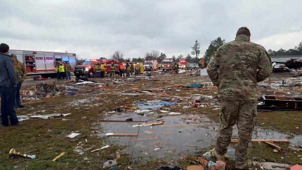 Image: A U.S. Air Force airman surveys debris covering an area of the Sunshine Acres neighborhood after a tornado struck Adel, Georgia, Jan. 22, 2017.