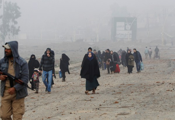 Image: Displaced people flee their homes as Iraqi forces battle with ISIS militants in Arabi neighborhood, north of Mosul