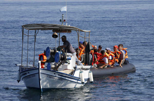 Image: Greek fishermen rescue Syrian Kurdish refugeess