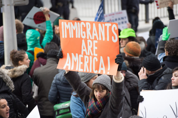 Image: Protesters gather at JFK International Airport's Terminal 4 to demonstrate against President Donald Trump's executive order on Jan. 28 in New York.