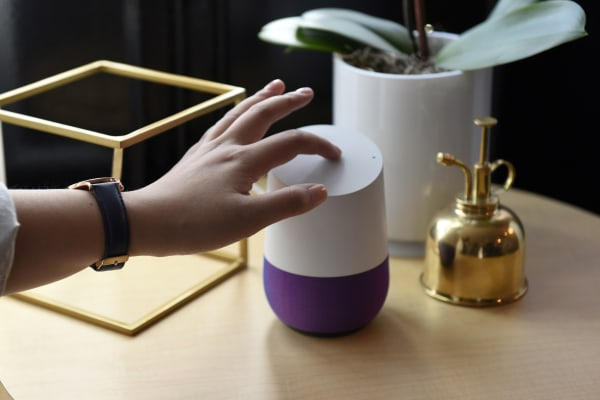 Image: An attendee demonstrates the new Google Inc. Home device during a product launch event in San Francisco, Calif. on Oct. 4.