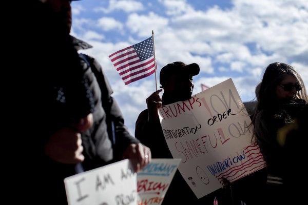 Image: Demonstrators hold signs at Hartsfield-Jackson International Airport during a demonstration on Jan. 29, 2017, in Atlanta.
