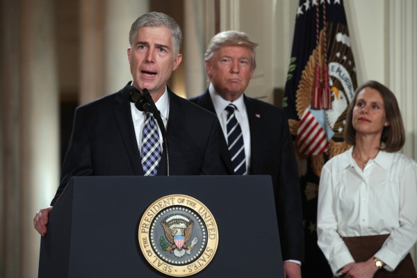 Image: Judge Neil Gorsuch delivers brief remarks after being nominated by President Donald Trump to the Supreme Court with his wife Marie Louise Gorshuch during a ceremony in the East Room of the White House on Jan. 31 in Washington, D.C.