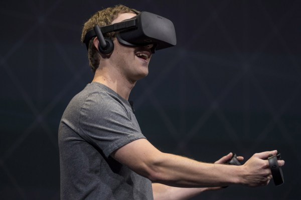 Image: Facebook founder and CEO,Mark Zuckerberg, demonstrates an Oculus Rift virtual reality (VR) headset and Oculus Touch controllers as the gives a demonstration during the Oculus Connect 3 event in San Jose, Calif., on Oct. 6, 2016.