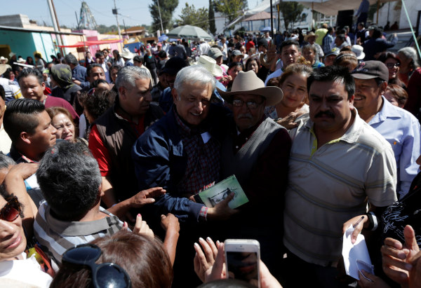 Image: MORENA party leader Obrador poses with supporters after he gave a speech in Tlapanoloya