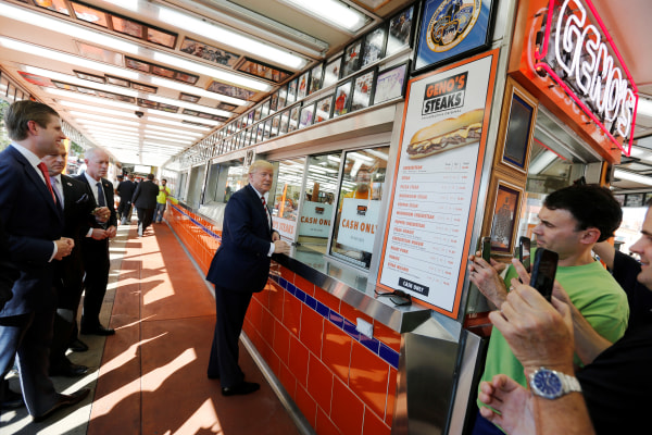 Republican presidential nominee Trump waits for his order on a stop at Geno's Steaks cheesesteak restaurant in Philadelphia