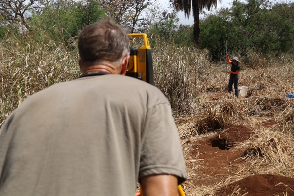 """The grass at the Honouliuli site is """"very thick and very heavy and you're trying to see what's on the ground. Your visibility is very low. It's very difficult to do,"""" William Belcher said, adding that the group spends a lot of time clearing the area with"""