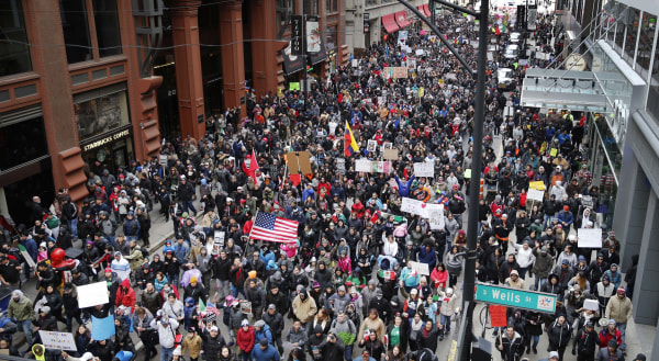 Image: Protesters participate in a march against efforts to crack down on immigration