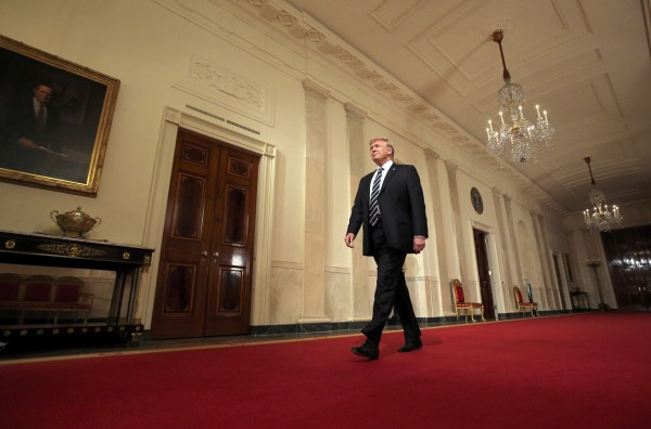 Image: President Donald Trump arrives to make an announcement at the White House