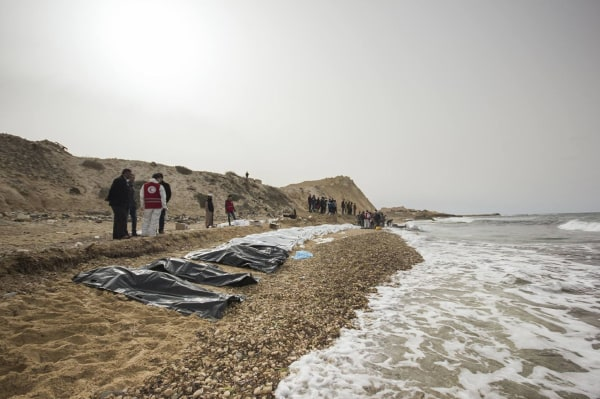 Image: Volunteers recover the bodies of 74 people near Zawiya, Libya