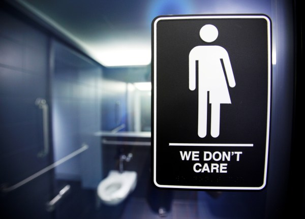 A sign protesting a recent North Carolina law restricting transgender bathroom access adorns in Durham.
