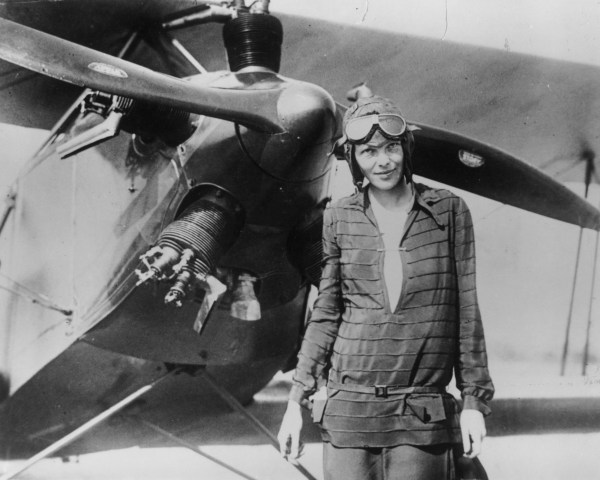 """Image: Amelia Earhart stands June 14, 1928 in front of her bi-plane called """"Friendship"""" in Newfoundland."""