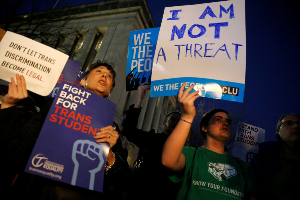 Image: Transgender activists and supporters protest near the White House in Washington