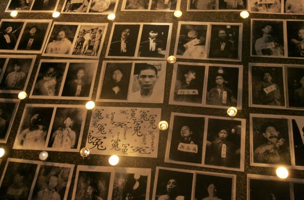 """Image: Pictures of victims of """"white terror"""" are displayed during a protest against Taiwan President Ma Ying-jeou in front of the Presidential Office in Taipei, Aug. 9, 2008."""