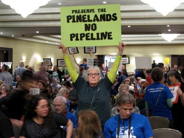 Image: Opponents of a proposed natural gas line that would run through New Jersey's federally protected Pinelands reserve gather inside a hotel in Cherry Hill New Jersey, Feb. 24, 2017.
