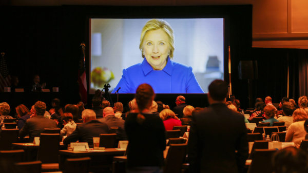 Image: Clinton delivers a videotaped address during the Democratic National Committee