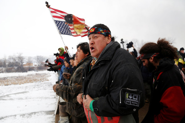 Image: Raymond Kingfisher of the Northern Cheyenne Tribe sings during a march on the outskirts of the main opposition camp against the Dakota Access oil pipeline near Cannon Ball