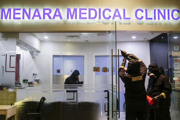 Image: A hazmat team investigates a clinic in Kuala Lumpur Internatinal Airport
