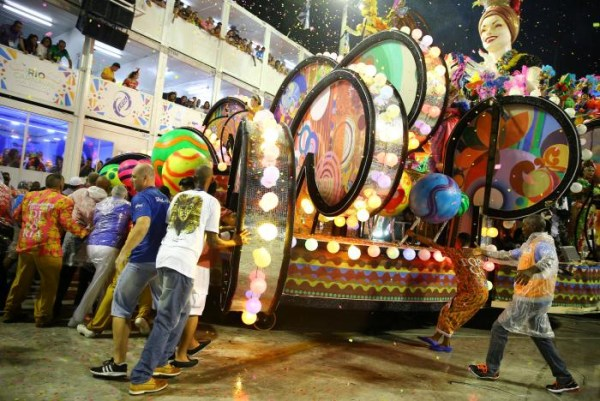 People try to move a parade float after an accident during the carnival parade at the Sambadrome in Rio de Janeiro, Brazil