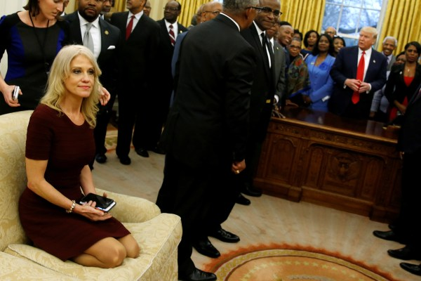 Image: Senior advisor Kellyanne Conway sits on a couch as U.S. President Donald Trump welcomes the leaders of dozens of historically black colleges and universities (HBCU) in the Oval Office at the White House in Washington