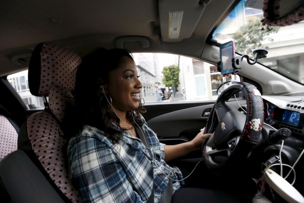 Image: Maya Jackson a Lyft driver from Sacramento looks for customers in San Francisco