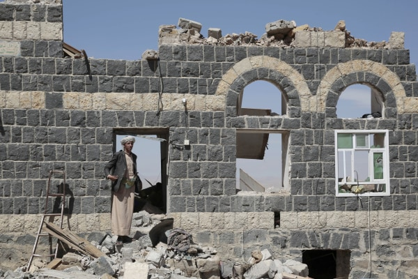 Image: A man stands on the rubble of a house destroyed by a Saudi-led airstrike in the outskirts of Sanaa, Yemen, Feb. 16, 2017.
