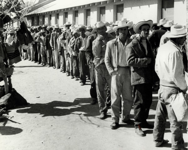 Image: Workers waiting in line to be contracted at the Rio Vista Farm Reception Center in Sacorro, Texas.