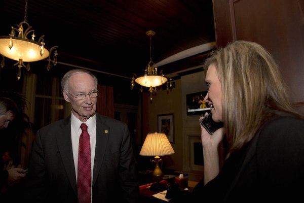 Image: Republican Gov. Robert Bentley listens to a phone call as Rebekah Mason, right, announces his win for Alabama governor, in Montgomery, Alabama, Nov. 4, 2014.