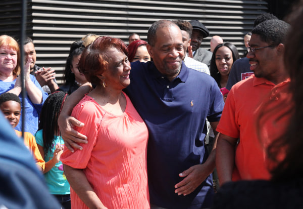 Image: Mildred Pinkins and her son Darryl Pinkins embrace outside the Lake County Jail in Crown Pointe, Ind., after he was released on April 25, 2016