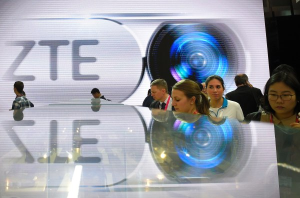 Image: Visitors test smart phones at the ZTE's stand during the Mobile World Congress in Barcelona, Spain on Feb. 23, 2016.