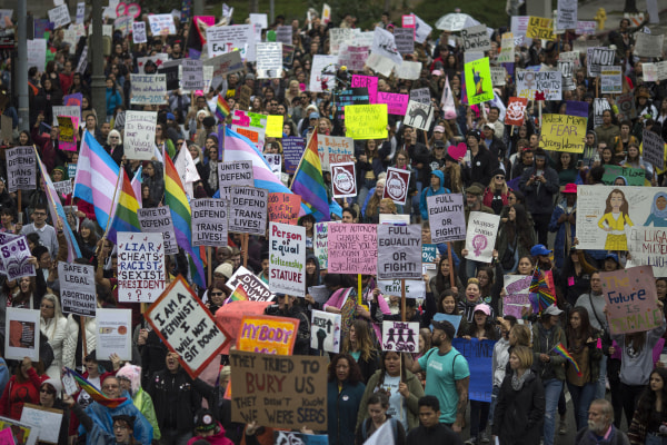 Image: Women march during the International Women's Day March and Rally