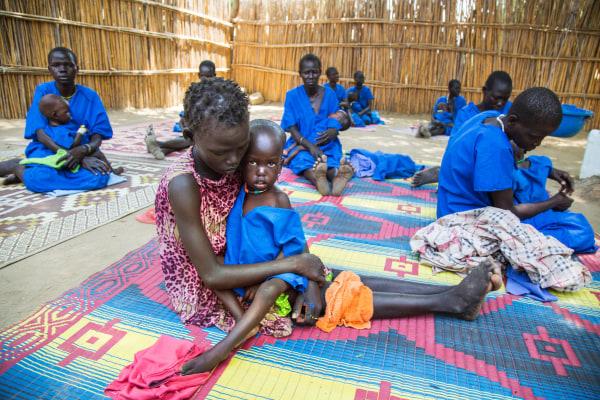 Image: Moms hold malnourished children in South Sudan