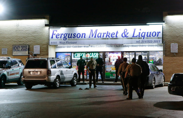 Image: Police line up in front of the Ferguson Market & Liquor during a protest in Ferguson