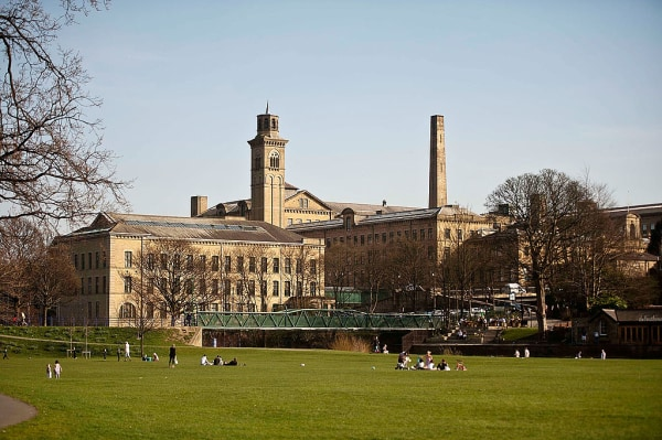 Visitors Enjoy The UNESCO World Heritage Site Of Saltaire