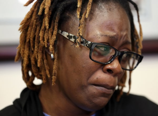 Image: Gina Alexis is overcome by emotion while talking about her daughter, Naika Venant
