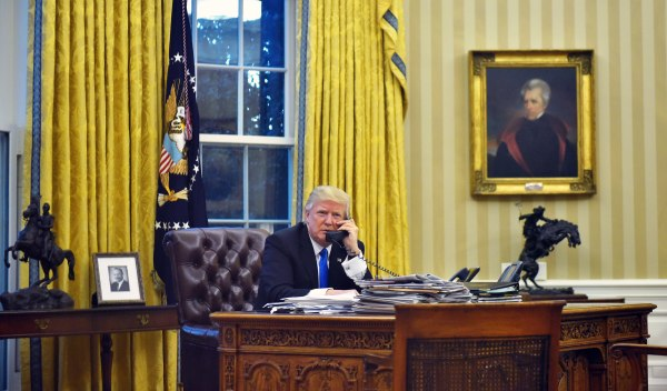 Image: President Donald Trump speaks on the phone with Australia's Prime Minister Malcolm Turnbull