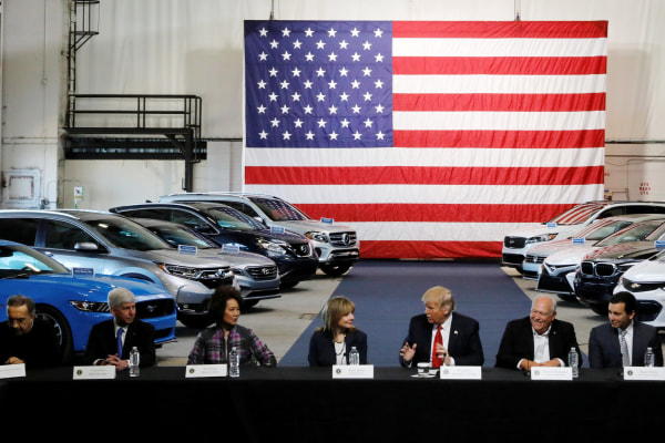 Image: Trump and Chao talk with auto industry leaders at the American Center for Mobility in Ypsilanti Township