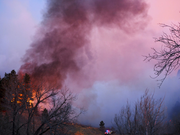 Image: Smoke rises from a wildfire Sunday, March 19, 2017, in Boulder, Colorado.