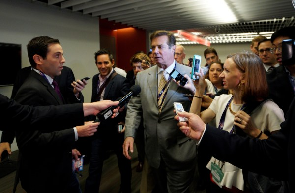 Image: Manafort, campaign manager to Republican Presidential Candidate Trump, is surrounded by reporters asking about the Republican National Convention Committee on Rules in Cleveland