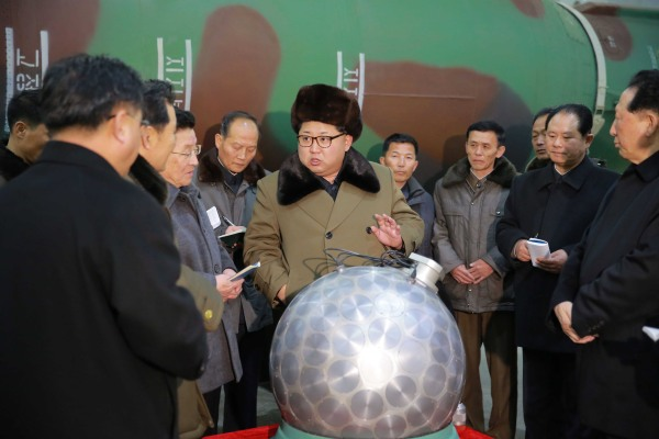 Image: Kim Jong-un talks with scientists and technicians involved in research of nuclear weapons