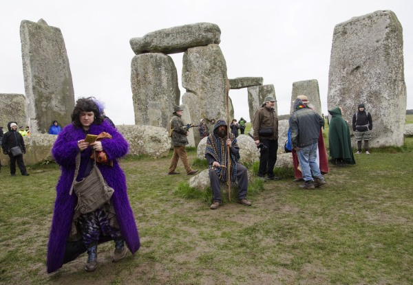 Image: A druid prays in the inner circle of Stonehenge