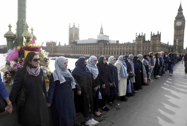 Image: Muslim women gather on Westminster Bridge