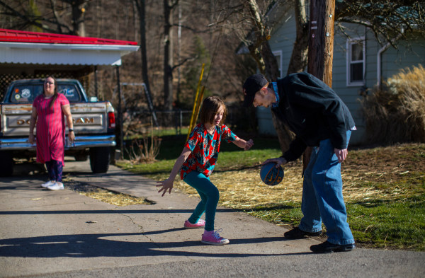 Image: Gabriella Corley plays basketball in the driveway of her home