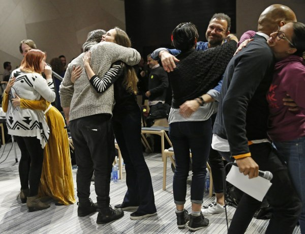 Image: Attendees embrace during an alcohol-free social evening sponsored by The Shine at a hotel in Williamsburg, Brooklyn on March 8, 2017