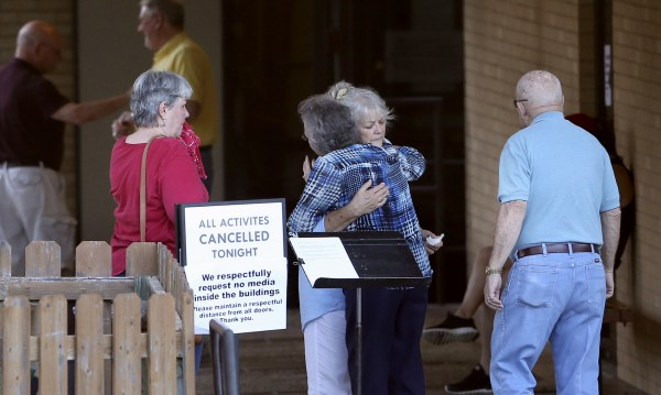 Image: People greet each other outside First Baptist Church after hearing news of the deaths of several members