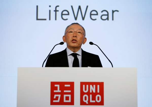 Image: Tadashi Yanai speaks during a news conference to mark the unveiling of the company's new headquarters building called UNIQLO CITY TOKYO in Tokyo