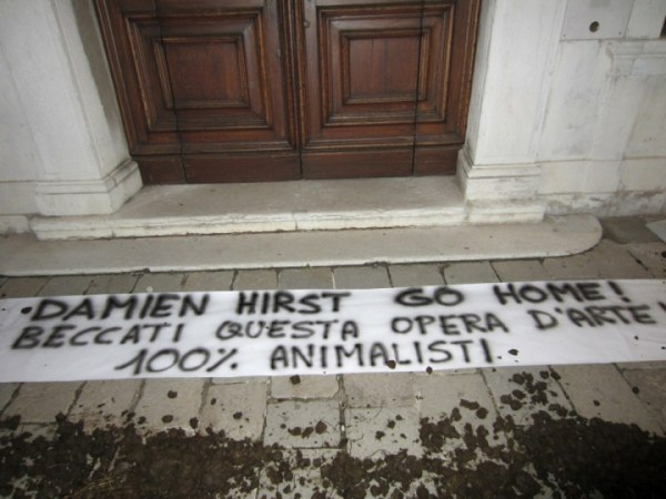 Image: Dung was placed outside the Palazzo Grassi in protest of Damien Hirst's latest exhibition